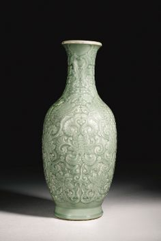 A RARE MOULDED AND CARVED CELADON-GLAZED VASE QIANLONG SEAL MARK AND PERIOD - Sotheby's