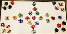 35 Floral Small Fancy Bindis in Wooden Gift Box, Bindi Box. 35 Floral Small Fancy Bindis in Wooden Gift Box,, Self Sticking Reusable Bindis. Small Bindis, World Class Rhinestone Bindi, Round Bindis, Fllower Bindis. Size : 9.7 cm X 5.5 cm X 2 cm Tall Box, with Many Rainbow color bindis,. Nail Art Bindi / Intimate tattoos/ craft supplies/ Wedding Return Gift Box/ thank you gift box. More Than 400 Designs to Choose from.