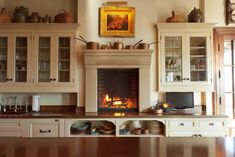 Kitchen with counter-level fireplace at beautiful Sagee Manor mountaintop retreat, Highlands, NC