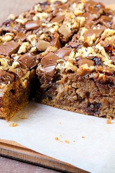 Caramel Bars Recipe with rolled oats, brown sugar, semi-sweet chocolate chips and walnuts.
