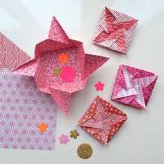 Traditional Japanese 'diagonal pinwheel tato' one sheet origami envelope - get instructions via the blog. Also get the cute Valentines' red/pink origami paper - free download, of course.