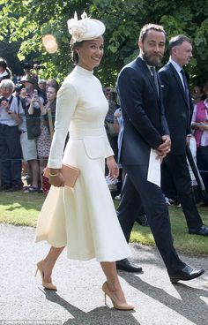 Pippa Middleton, wearing Designer: Jane Taylor millinery. It is a bespoke piece, similar to the Nitra design. Dress by Emilia Wickstead, for the Christening of Princess Charlotte of Cambridge on July 5, 2015 in King's Lynn, England