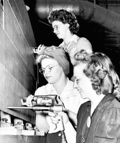 """With millions of men inducted into the armed forces during World War II, women flooded into factories to do """"men's work"""" here at home. - WWII propaganda photo USA, women war workers"""