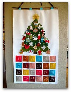 """This reminds me of the advent calendar I had as a child. But with mine the tree was on a night sky background, and the """"ornaments"""" were angels and fabric people from around the world. It was a special """"Christmas toy"""", since playing with the people was much more fun than decorating the tree."""