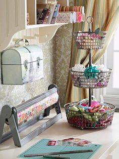 A three-tiered basket is perfect for storing wrapping odds and ends. Find more craft room storage ideas: http://www.bhg.com/decorating/storage/craft-room/?socsrc=bhgpin071812threetierstoragebasket