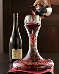 Twister Wine Aerator & Decanter with Stand Set from Williams-Sonoma.The spiral funnel of this aerator/decanter combo adds more oxygen to the wine as it flows into the wide base of the decanter. Red Wine Decanter, Crystal Decanter, Barolo Wine, Red Wine Glasses, Alcohol Glasses, Nice Glasses, Deco Originale, Expensive Wine, Wine Fridge