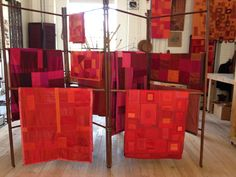 a small grouping of my textiles in the family of reds... by Denise Carbonell of Metal & Thread at the Cotton Mill Studios #asheville #avlart #riverartsdistrict