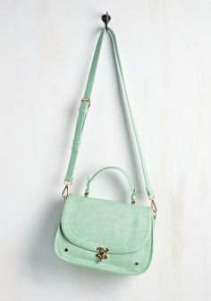Major Manuscript Bag. The day has finally come to meet with a potential publisher, and with this mint satchel over your shoulder, you emanate the aura of an author on-the-rise! #mint #modcloth