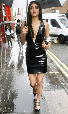 Leggy display: She paraded her lithe legs in a pair of black lace-up stilettos and accesso...