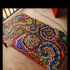 DIY bottle cap table. Totally want to make this!