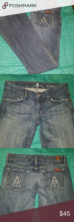 "7 For All Mankind Jeans Medium blue denim jeans from 7 for All Mankind. Inseam 30.5 inches. Leg opening 9 inches. Waist 26 inches. Cotton and spandex. ""A"" Pocket flare design. 7 For All Mankind Jeans Overalls"