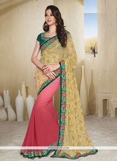 Rich look attire to give your a right choice for any party or function. Be the sunshine of anyone's eyes dressed with this interesting pink net designer saree. The ethnic embroidered and patch borde...