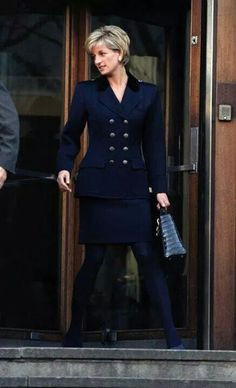 Princess Diana looks so corporate chic in her midnight blue suit.