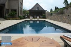 Hydrazzo French Gray makes the pool look great, and French Gray makes the it easy to match your outdoor decor. Water Scapes Backyard Resorts #swimmingpool #pool