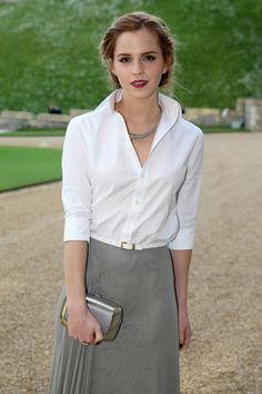 The Duke of Cambridge's Royal Dinner, May 2014 A soft updo and a deep berry lipstick add to the sophistication of Emma's shirt-dress ensemble. Well done!