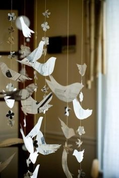 DIY bird garland. Can be made from book pages sprayed with stiffy. Can do cut outs like scherenschnitt which is more ornate papercutting. That would allow for messages like Silent night, peace, etc