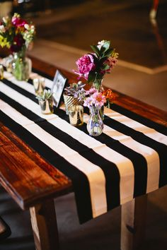 striped table runner, photo by Lang Photographers http://ruffledblog.com/phoenix-icehouse-wedding #tablerunner #stripedtablecloth #weddingideas