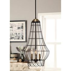 Add a touch of effulgent style to any space with the Birdie Cage Mini Chandelier, highlighting a stunning distressed iron finish. This three-light fixture also spotlights contemporary styling with its wire shade.