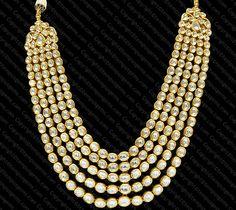 Necklace with 5 Rows Polki and intricate Meena word on the back set in 18K Gold.#mughal #designerjewelry #bridaljewelry #bridalfashion #tempusgems #indianfashion