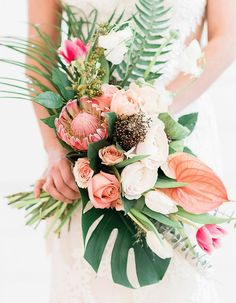 These Are Summer 17's Trendiest Wedding Bouquets - Wilkie Blog! - Striking and vibrant tropical blooms with green accents