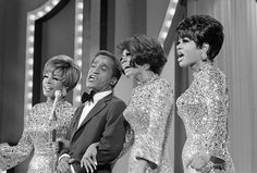 "Sammy Davis Jr., sings along with Diana Ross & The Supremes on the "" Hollywood Palace"" television show on October 2, 1967. From left: Mary Wilson, Davis Jr., Diana Ross, leader of the group and Cindy Birdsong. She replaced Florence Ballard who had left the group recently."