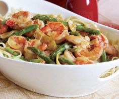 Hot Garlicky Shrimp with Asparagus & Lemon: 1 lb. shrimp (21 to 25 per lb., peeled, deveined, rinsed, and patted dry), 3/4 tsp. kosher salt (more as needed), Freshly ground black pepper, 1 lemon, 6 Tbs. extra-virgin olive oil, 4 medium cloves garlic (thinly sliced), 3/4 lb. asparagus (bottoms snapped off, halved lengthwise if thick, and cut into 2-inch lengths - 2 cups), 1/8 to 1/4 tsp. crushed red pepper flakes, 2/3 cup low-salt chicken broth, 1/2 tsp. cornstarch