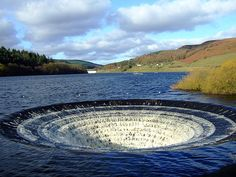 Ladybower Reservoir  View of the Bell Mouth spillway of Ladybower Reservoir. Water drops down the funnel and exits through a pipe under the dam.
