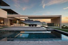 A Cliff-side Home With Panoramic Mountain and Sea Views by SAOTA