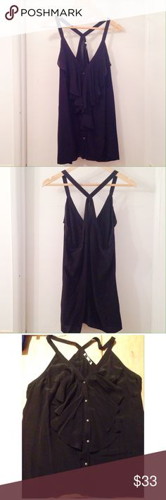 "NWOT Racerback Ruffle Top Gorgeous silky ruffle top from BR. Never worn, one of those ""I'll fit into it one day"" purchases... Soft black in color. Racer back with contrast straps, and little silver buttons. This top is simply beautiful, perfect for a night out. 💃🏻👏🏻 Banana Republic Tops Tank Tops"