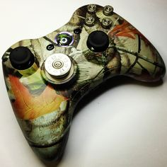 For all the rednecks out there!  A Realtree Camo Xbox 360 modded controller from www.intensafirestore.com. This controller comes complete with real 9mm nickel plated ABXY buttons and a shotgun shell D-Pad.  Just $114.95.