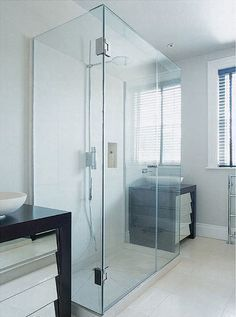 three-sided glass shower enclosure