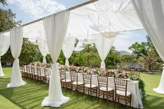 White Drapery at Outdoor Bridal Shower | Photography: Brett Hickman Photographers. Read More: http://www.insideweddings.com/weddings/romantic-vintage-inspired-outdoor-bridal-shower-with-pastel-decor/736/