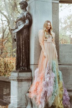 Puck Loomans strikes a pose in Gucci feather embroidered dress