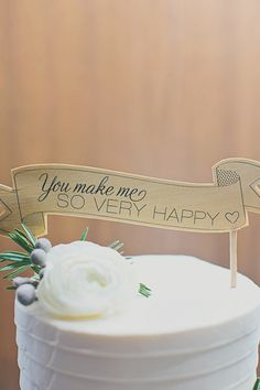 Cake Topper | Photo: Our Labor of Love | On #StyleMePretty: http://www.stylemepretty.com/2013/04/05/woodstock-vermont-wedding-from-lauren-wells-events-our-labor-of-love/
