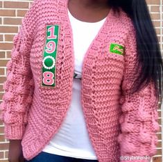 Check out our Pearl Collection Chunky Embroidered Pom Pom Sweater. Get this look from our latest collection now availabl. Aka Sorority, Alpha Kappa Alpha Sorority, Alpha Shirt, Sorority Gifts, Pink And Green Dress, Pom Pom Sweater, Everything Pink, New Instagram, Pretty Girls