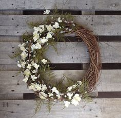 A rustic White Wreath perfect for any occasion!    This item is an 18 Grapevine wreath with beautiful white flowers, intertwined with pussy willow