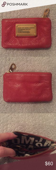 Marc by Marc Jacobs leather coin pouch Top zip closure. Brand name hardware plaque. Woven jumbled logo interior lining. Slight wear and tear as seen in photos...small pen marks on back. Marc by Marc Jacobs Accessories Key & Card Holders