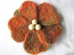 Felted flower hairclip, brooch orange, yellow, green. $20.00, via Etsy.