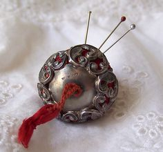 Antique Sterling Pin Cushion Emery Needle Sharpener Strawberry Pin Cushion Sterling Silver Top 1800s by cynthiasattic on Etsy https://www.etsy.com/listing/237675899/antique-sterling-pin-cushion-emery