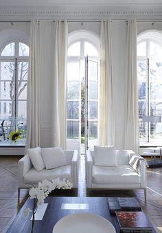 Bismut & Bismut chose an all-white palette for this former hôtel particulier in Paris to accentuate the property's incredible light and expansive gardens. The floor lamp in the rear of the photo is a custom design by the firm.