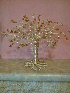 Wire tree with gold beads.