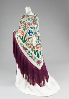 """Shawl ca. 1885-1910 via The Costume Institute of The Metropolitan Museum of Art  One fashion piece which I dearly hope to own someday is a large """"piano shawl,"""" which is sometimes also referred to as a """"Spanish shawl"""" for their popularity among Spanish women. However, in my research of the pieces, the earlest examples of these elaborately embroidered, long-fringed shawls are all Chinese. My personal theory behind this is that they first were picked up by the Spanish in th"""