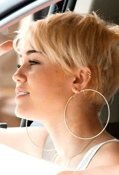 Miley Cyrus short hair from the side.