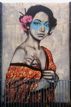 There's a spray painted image on the wall. A beautiful girl, slowly revealing her right breast from the bright colored kimono, hidden underneath the orange, decorated fabric is branches, with tiny pink rosebuds peeking from them. Her eyes are those of a broken, violated woman. They are covered in blue paint, so you cannot see her tears. This is mother nature.
