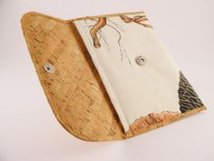 Multipurpose envelope like wallet made from cork and white cotton fabric with flowers