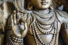 Hinduism 101: The Basics for Beginners: Om, the sacred symbol of Hinduism, is pictured on the palm of a Shiva statue