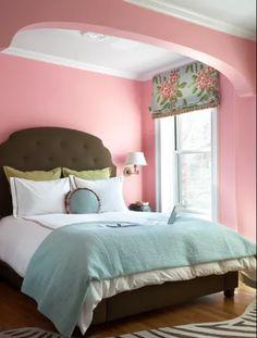 Pink, brown and blue bedroom.