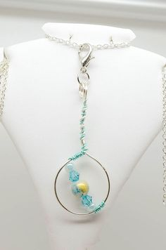 Through - Silver plated pendant with glass and acrylic beads by BiancaFerrando on Etsy