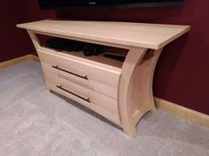 Entertainment center in maple by Sam McClure - Fine Woodworking #finewoodwork