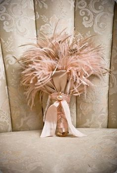 A sweetly elegant dusty pink feather bouquet. #wedding #bouquet #pink #feathers #shabby #chic #girly